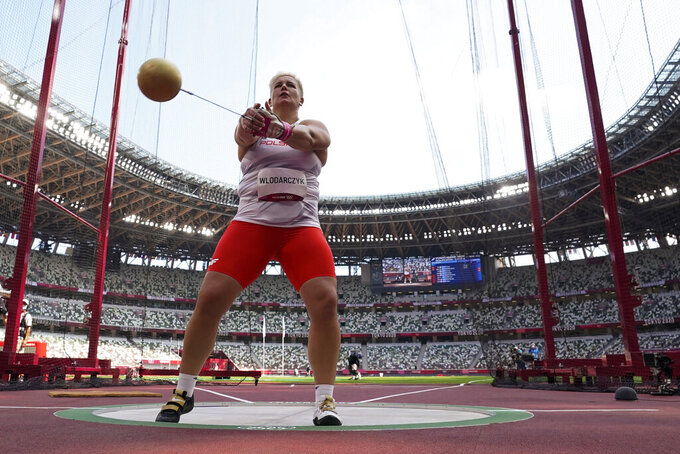 Anita Wlodarczyk, of Poland, competes in the women's hammer throw at the 2020 Summer Olympics, Sunday, Aug. 1, 2021, in Tokyo. (AP Photo/David J. Phillip)