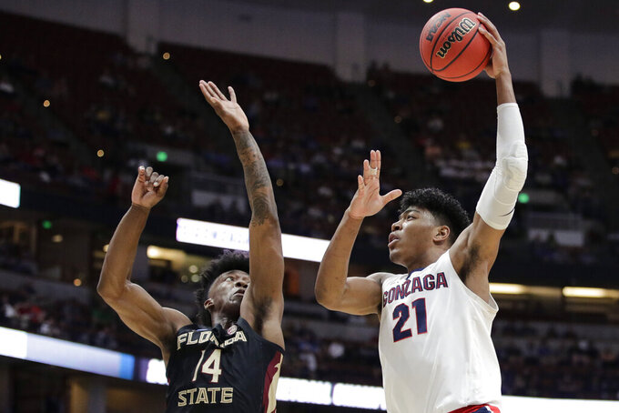 Gonzaga forward Rui Hachimura, right, shoots over Florida State guard Terance Mann during the first half an NCAA men's college basketball tournament West Region semifinal Thursday, March 28, 2019, in Anaheim, Calif. (AP Photo/Jae C. Hong)