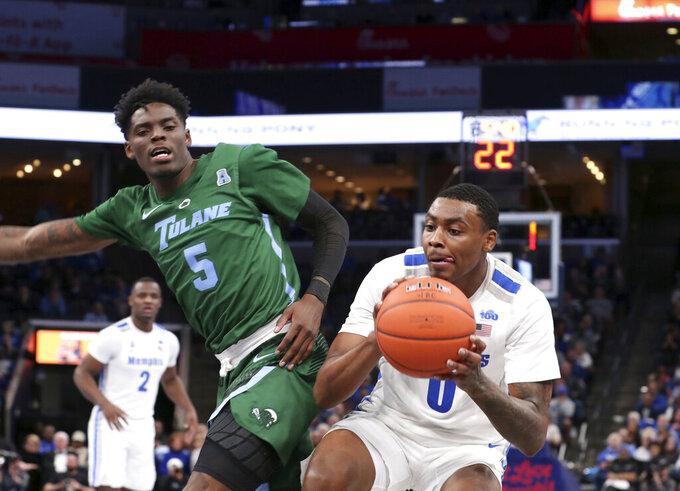 Memphis' forward D.J. Jeffries pushes past Tulane guard Teshaun Hightower (5) in the second half of an NCAA college basketball game Monday, Dec. 30, 2019, in Memphis, Tenn. (AP Photo/Karen Pulfer Focht)