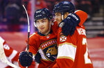 Florida Panthers center Alex Wennberg (21) celebrates an overtime goal against the Detroit Red Wings with teammate center Frank Vatrano (77) during an NHL hockey game Thursday, April 1, 2021, in Sunrise, Fla. (AP Photo/Jim Rassol)
