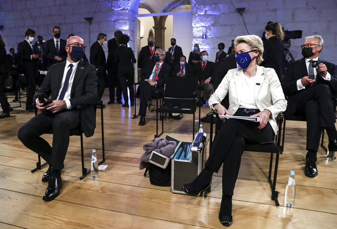 European Commission President Ursula von der Leyen, right, and European Council President Charles Michel, left, wait for the start of the opening ceremony at an EU summit at the Alfandega do Porto Congress Center in Porto, Portugal, Friday, May 7, 2021. European Union leaders meet for a summit in Portugal on Friday, sending a signal they see the threat from COVID-19 on their continent as waning amid a quickening vaccine rollout. Their talks hope to repair some of the damage the coronavirus has caused in the bloc, in such areas as welfare and employment. (Tiago Petinga, Pool via AP)