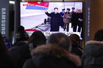 People watch a TV screen showing a file image of North Korean leader Kim Jong Un during a news program at the Seoul Railway Station in Seoul, South Korea, Wednesday, Jan. 1, 2020. Kim accused the Trump administration of dragging its feet in nuclear negotiations and warned that his country will soon show a new strategic weapon to the world as it bolsters its nuclear deterrent in the face of