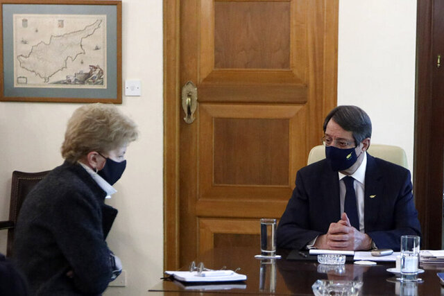 In this photo released from Cyprus' Press and Information Office, Cyprus President Nicos Anastasiades, right, and United Nations Secretary General advisor Jane Holl Lute talk during their meeting at the presidential palace in divided capital Nicosia, Cyprus, on Monday, Jan. 11, 2021. Lute is meeting both leaders separately in order to prepare the ground for reunification talks. (Stavros Ioannides/Cyprus' Press and Information Office via AP)