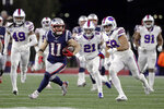 New England Patriots wide receiver Julian Edelman (11) runs from Buffalo Bills defenders after catching a pass in the second half of an NFL football game, Saturday, Dec. 21, 2019, in Foxborough, Mass. (AP Photo/Steven Senne)
