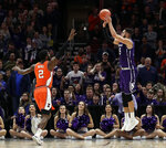 Northwestern forward Aaron Falzon, right, shoots against Illinois forward Kipper Nichols during overtime of an NCAA college basketball game in the first round of the Big Ten Conference tournament in Chicago, Wednesday, March 13, 2019. Illinois won 74-69 in overtime. (AP Photo/Nam Y. Huh)