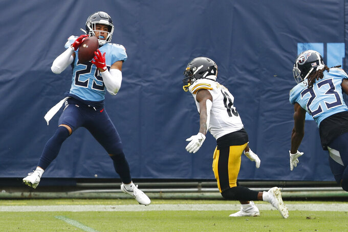 Tennessee Titans defensive back Dane Cruikshank (29) intercepts a pass intended for Pittsburgh Steelers wide receiver Diontae Johnson (18) in the first half of an NFL football game Sunday, Oct. 25, 2020, in Nashville, Tenn. (AP Photo/Wade Payne)