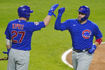 Chicago Cubs' Victor Caratini, right, celebrates with Jason Kipnis after hitting a two-run home run against the Chicago White Sox during the sixth inning of a baseball game in Chicago, Friday, Sept. 25, 2020. (AP Photo/Nam Y. Huh)