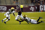 Texas A&M's Chase Lane (2) is tackled by Vanderbilt's Jaylen Mahoney (23) as Randall Haynie (4) helps defend during the second half of an NCAA college football game Saturday, Sept. 26, 2020, in College Station, Texas. Texas A&M won 17-12. (AP Photo/David J. Phillip)