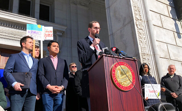 California state Sen. Scott Wiener announces he will introduce legislation to take over Pacific Gas & Electric at a rally in San Francisco Monday, Feb. 3, 2020. The legislation is aimed at transforming the nation's largest electric utility into a publicly-owned company. Wiener said the bill would involve a public takeover of Pacific Gas & Electric and its sprawling network of power lines that have been blamed for starting catastrophic wildfires that have killed dozens of people and caused billions of dollars in damage. (AP Photo/Janie Har)