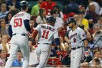 Minnesota Twins' Jorge Polanco (11) celebrates his two-run home run with Luis Arraez (2) that also drove in Brent Rooker (50) during the seventh inning of a baseball game against the Boston Red Sox, Tuesday, Aug. 24, 2021, in Boston. (AP Photo/Michael Dwyer)