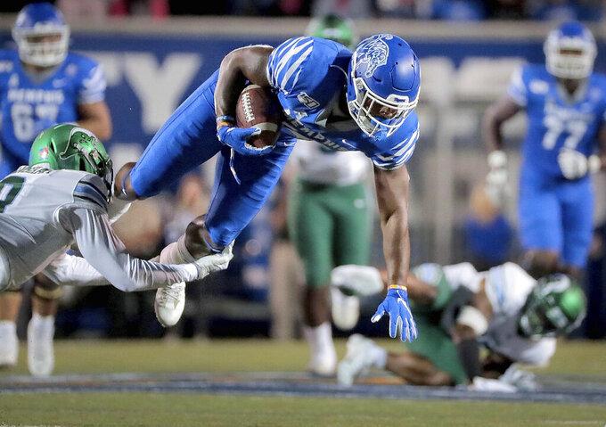 Memphis receiver Antonio Gibson is taken down by Tulane's Willie Langham during an NCAA college football game Saturday, Oct. 19, 2019, in Memphis, Tenn. (Jim Weber/Daily Memphian via AP)