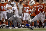 Kansas running back Pooka Williams Jr. (1) runs the ball as Texas defensive back Brandon Jones (19) pursues during an NCAA college football game Saturday, Oct. 19, 2019, in Austin, Texas. (Nick Wagner/Austin American-Statesman via AP)