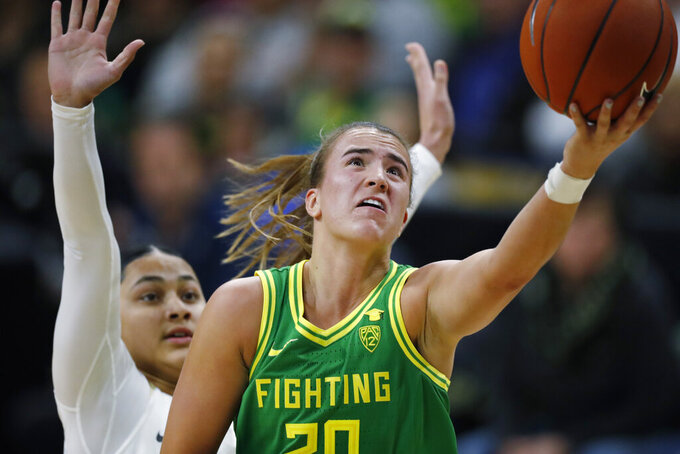 Oregon guard Sabrina Ionescu, front, drives to the rim for a basket past Colorado guard Lesila Finau late in the first half of an NCAA college basketball game Saturday, Feb. 1, 2020, in Boulder, Colo. (AP Photo/David Zalubowski)
