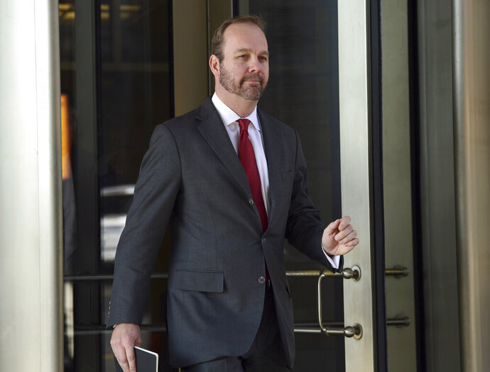 "FILE - In this Dec. 11, 2017 file photo, then Deputy Trump campaign aide Rick Gates, departs federal court in Washington. Gates, the former Trump campaign aide and a key cooperator in the special counsel's Russia probe, is not ready to be sentenced because he continues to help with ""several ongoing investigations,"" prosecutors said in a court filing Friday. (AP Photo/Susan Walsh)"