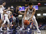 Gonzaga forward Jeremy Jones, right, and Pepperdine guard Jade' Smith go after the ball during the first half of an NCAA college basketball game in Spokane, Wash., Thursday, Feb. 21, 2019. (AP Photo/Young Kwak)