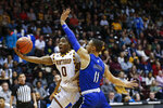 Winthrop guard Russell Jones, left, drives to the basket against Hampton guard Dondre Griffin during the first half of an NCAA college basketball game for the Big South tournament championship in Rock Hill, S.C., Sunday, March 8, 2020. (AP Photo/Nell Redmond)