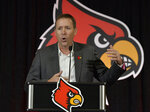 FILE - In this Dec. 4, 2018, file photo, new Louisville NCAA college football head coach Scott Satterfield speaks to the media in Louisville, Ky. The 2019 Most Likely to Succeed list ranks the new hires in FBS. (AP Photo/Timothy D. Easley, File)