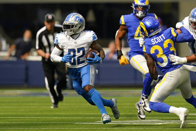 Detroit Lions running back D'Andre Swift runs for a touchdown after a reception during the first half of an NFL football game against the Los Angeles Rams, Sunday, Oct. 24, 2021, in Inglewood, Calif. (AP Photo/Marcio Jose Sanchez)