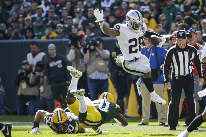 Oakland Raiders' Josh Jacobs runs during the first half of an NFL football game against the Green Bay Packers Sunday, Oct. 20, 2019, in Green Bay, Wis. (AP Photo/Mike Roemer)