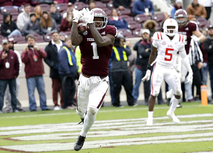 Texas A&M wide receiver Quartney Davis (1) catches a pass in the end zone for a touchdown during the fourth quarter of an NCAA college football game against Mississippi Saturday, Nov. 10, 2018, in College Station, Texas. Texas A&M won 38-24. (AP Photo/David J. Phillip)