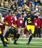 Michigan kicker Jake Moody (2) observes his field goal attempt with his holder, punter Will Hart (17), in the first quarter of an NCAA college football game against Indiana in Ann Arbor, Mich., Saturday, Nov. 17, 2018. Michigan won 31-20. (AP Photo/Tony Ding)