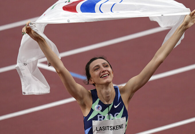Mariya Lasitskene, of Russian Olympic Committee, reacts after winning the women's high jump final at the 2020 Summer Olympics, Saturday, Aug. 7, 2021, in Tokyo. (AP Photo/Francisco Seco)