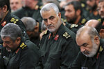 FILE - In this Sept. 18, 2016 file photo released by an official website of the office of the Iranian supreme leader, Revolutionary Guard Gen. Qassem Soleimani, center, attends a meeting in Tehran, Iran. As Iran's frontman in Syria since 2011, Soleimani helped turn the tide in the now 9-year-old civil war, intervening to save Assad as armed rebels reached the capital Damascus and seized several key cities. (Office of the Iranian Supreme Leader via AP, File)