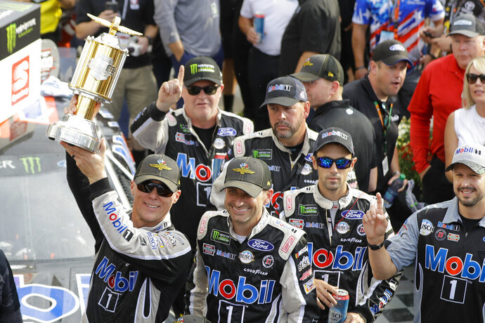 Kevin Harvick, left, celebrates after winning the NASCAR Brickyard 400 auto race at Indianapolis Motor Speedway, Sunday, Sept. 8, 2019, in Indianapolis. (AP Photo/Darron Cummings)