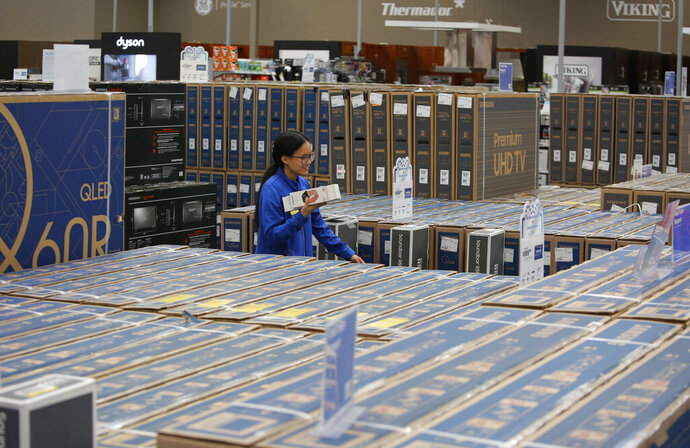 FILE - In this Nov. 26, 2019, file photo boxes of televisions fill isles ahead of Black Friday at a Best Buy in Henderson, Nev. Best Buy reports earnings Thursday, Feb. 27. (AP Photo/John Locher, File)