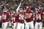 Oklahoma running back Kennedy Brooks (26) celebrates with offensive lineman Creed Humphrey (56) after rushing for a touchdown against Baylor during the first half of an NCAA college football game for the Big 12 Conference championship, Saturday, Dec. 7, 2019, in Arlington, Texas. (AP Photo/Jeffrey McWhorter)