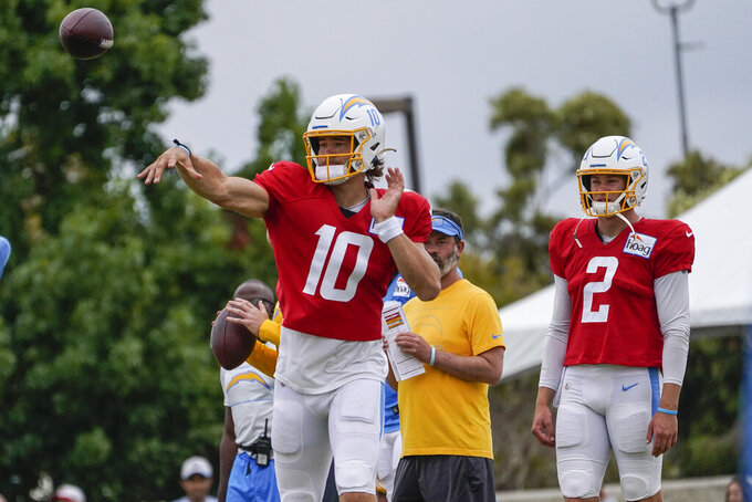 Los Angeles Chargers quarterbacks, Justin Herbert, left, and Easton Stick practice as the Chargers and the San Francisco 49ers hold a joint NFL football team practice in Costa Mesa, Calif., Friday, Aug. 20, 2021. (AP Photo/Damian Dovarganes)