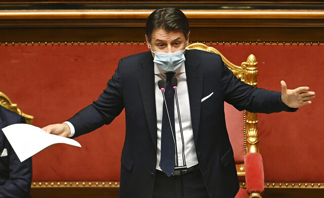 Premier Giuseppe Conte delivers his speech at the Senate, in Rome, Tuesday, Jan. 19, 2021. Conte fights for his political life with an address aimed at shoring up support for his government, which has come under fire from former Premier Matteo Renzi's tiny but key Italia Viva (Italy Alive) party over plans to relaunch the pandemic-ravaged economy. (Andreas Solaro/Pool via AP)