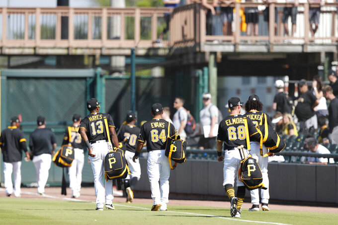 Members of the Pittsburgh Pirates leave the field after a spring training baseball game against the Toronto Blue Jays, Thursday, March 12, 2020, in Bradenton, Fla. (AP Photo/Carlos Osorio)