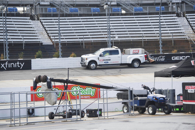 The track is dried before a NASCAR Cup Series auto race at Martinsville Speedway in Martinsville, Va., Sunday, Nov. 1, 2020. (AP Photo/Lee Luther Jr.)