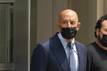 Tom Barrack leaves Brooklyn federal court, Monday, July 26, 2021, in New York. Barrack was among three men charged in New York federal court with trying to influence foreign policy while Donald Trump was running in 2016 and later while president. The chair of former President Donald Trump's 2017 inaugural committee allegedly conspired to influence U.S. policy to benefit the United Arab Emirates, even while he was seeking a position as an American diplomat. (AP Photo/Mark Lennihan)