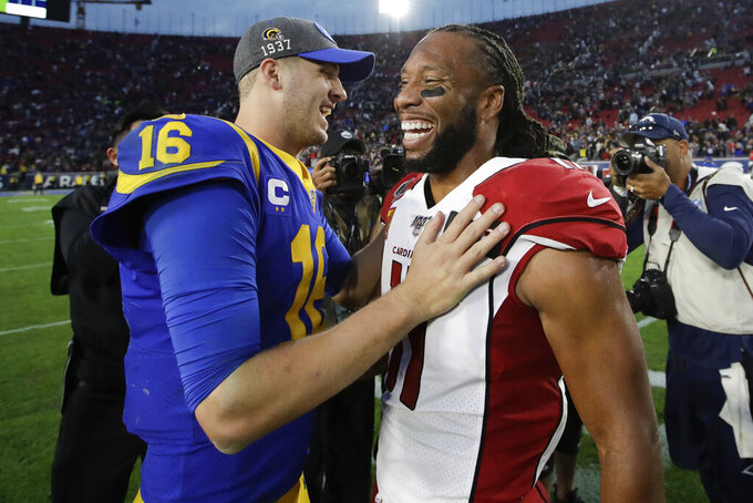 Arizona Cardinals wide receiver Larry Fitzgerald, right, greets Los Angeles Rams quarterback Jared Goff after an NFL football game Sunday, Dec. 29, 2019, in Los Angeles. (AP Photo/Marcio Jose Sanchez)