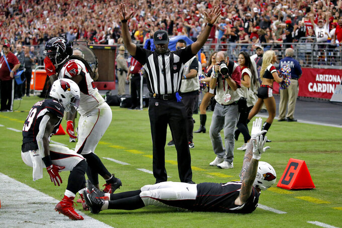 Arizona Cardinals tight end Maxx Williams (87) celebrates his touchdown against the Atlanta Falcons with teammate Chase Edmonds (29) during the second half of an NFL football game against the Atlanta Falcons, Sunday, Oct. 13, 2019, in Glendale, Ariz. (AP Photo/Ross D. Franklin)