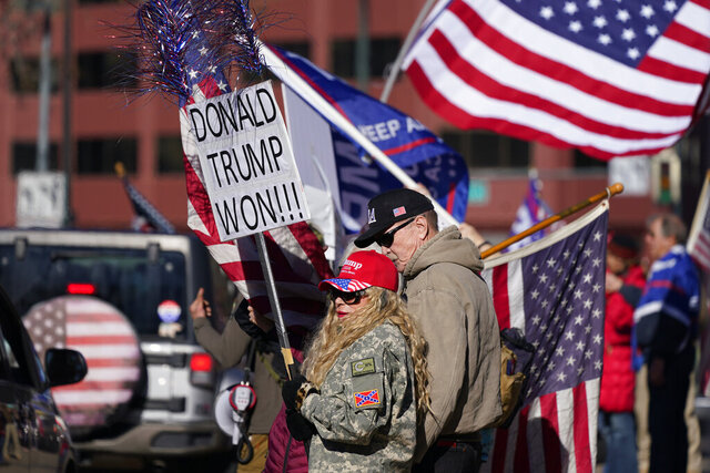 People attend a rally in support of President Donald Trump, Wednesday, Jan. 6, 2021, outside the State Capitol in downtown Denver. (AP Photo/David Zalubowski)