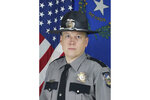 In this undated photo provided by the Nevada Highway Patrol shows Trooper Micah May. May, 46, died Thursday, July 29,2021, after he was struck and critically injured by a vehicle while deploying spike strips Tuesday to stop a chase on a busy freeway near the Las Vegas Strip. (Nevada Highway Patrol via AP)