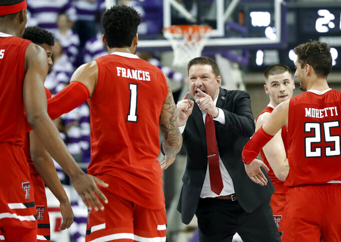 Texas Tech head coach Chris Beard, center, cheers on Tariq Owens (11), Brandone Francis (1), Davide Moretti (25) and Matt Mooney, right rear, during a time out late in the second half of an NCAA college basketball game against TCU in Fort Worth, Texas, Saturday, March 2, 2019. (AP Photo/Tony Gutierrez)