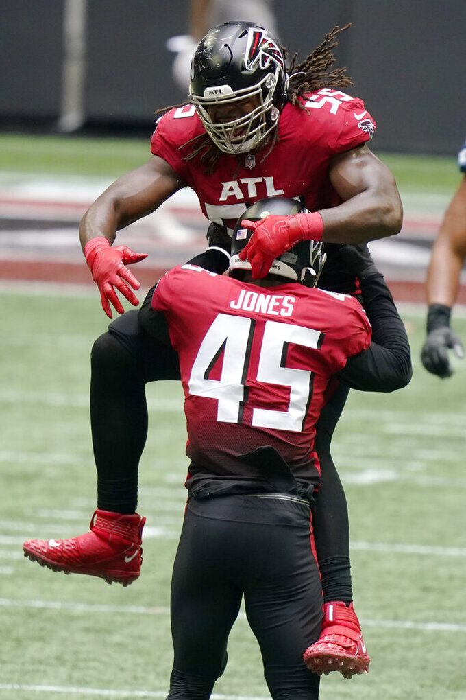 Atlanta Falcons defensive end Steven Means (55) celebrates the sack of Detroit Lions quarterback Matthew Stafford by Atlanta Falcons linebacker Deion Jones (45) during the second half of an NFL football game, Sunday, Oct. 25, 2020, in Atlanta. (AP Photo/Brynn Anderson)