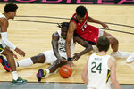 Baylor's Jonathan Tchamwa Tchatchoua (23) and Louisiana-Lafayette's Theo Akwuba scramble for the ball during the first half of an NCAA college basketball game Saturday, Nov. 28, 2020, in Las Vegas. (AP Photo/John Locher)