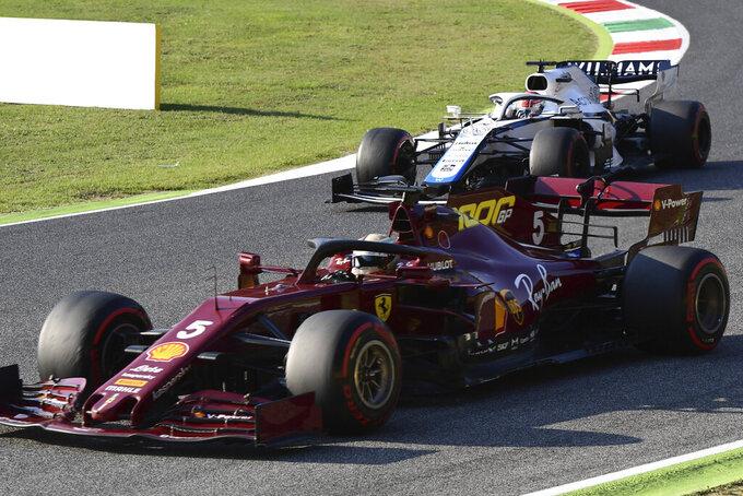 Ferrari driver Sebastian Vettel of Germany steers his car during Formula One Grand Prix of Tuscany, at the Mugello circuit in Scarperia, Italy, Sunday, Sept. 13, 2020. (Miguel Medina, Pool via AP)