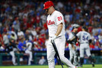 Philadelphia Phillies' Jay Bruce walks off the field after popping out in foul territory out to end the team's baseball game against the Miami Marlins, Friday, June 21, 2019, in Philadelphia. Miami won 2-1. (AP Photo/Matt Slocum)