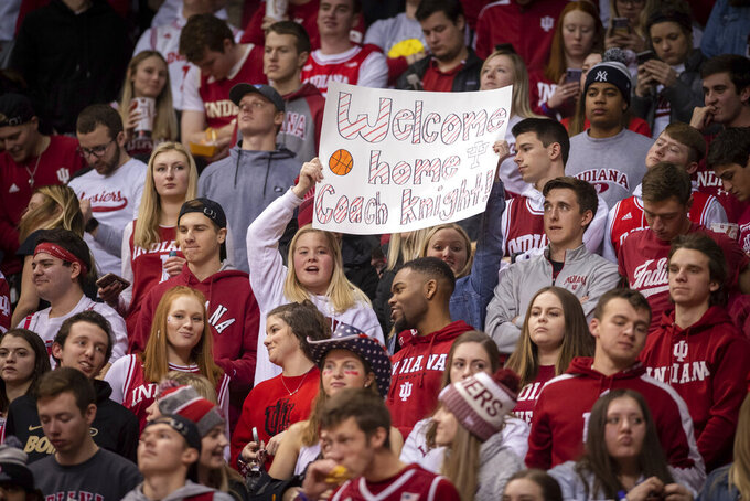Indiana fans hold up a sign in anticipation of an appearance by former Indiana basketball coach Bobby Knight before the first half of an NCAA college basketball game, Saturday, Feb. 8, 2020, in Bloomington, Ind. (AP Photo/Doug McSchooler)