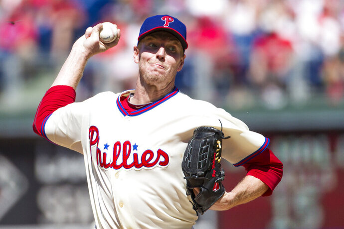 File-This Aug. 25, 2013, file photo shows Philadelphia Phillies starting pitcher Roy Halladay throwing a pitch during the third inning of a baseball game in Philadelphia. Halladay, an ace with the Toronto Blue Jays and Philadelphia Phillies, got 85.4 percent and will be the first posthumous inductee since Deacon White in 2013 and Ron Santo in 2012. Halladay died in November 2017 at 40 years old when an airplane he was flying crashed into the Gulf of Mexico off the coast of Florida.  (AP Photo/Christopher Szagola, File)