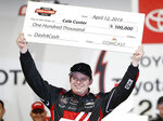 Cole Custer celebrates after winning a NASCAR Xfinity Series auto race in Victory Lane at Richmond International Raceway in Richmond, Va., Friday, April 12, 2019. (AP Photo/Steve Helber)