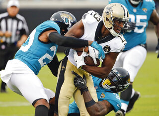APTOPIX Saints Jaguars Football