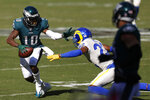 Philadelphia Eagles' DeSean Jackson, left, tries to slip past Los Angeles Rams' Troy Hill during the second half of an NFL football game, Sunday, Sept. 20, 2020, in Philadelphia. (AP Photo/Laurence Kesterson)