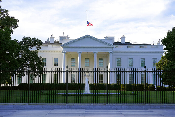 An American flag flies at half-staff over the White House in Washington, Saturday, Sept. 19, 2020, the morning after the death of Supreme Court Justice Ruth Bader Ginsburg. (AP Photo/Patrick Semansky)